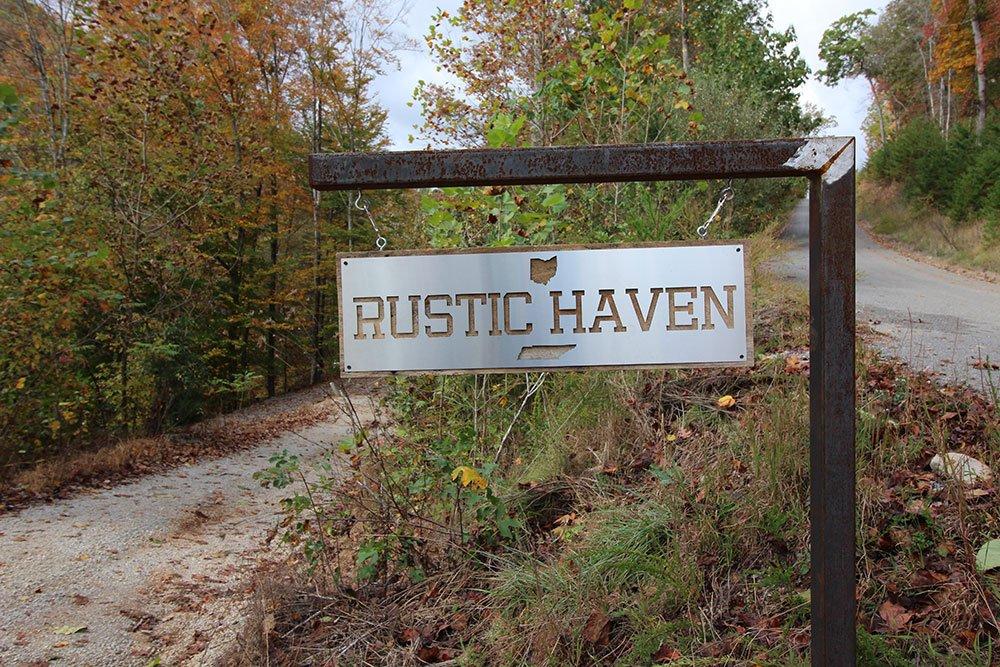 Norris Lake Villas | Norris Lake Cabin Rentals | Rustic Heaven Lakeside Cabin View of Sign