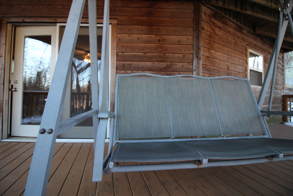 Norris Lake Cabin Rentals | Harmony Hill Lakeside Cabin Porch Swing | Norris Lake Villas