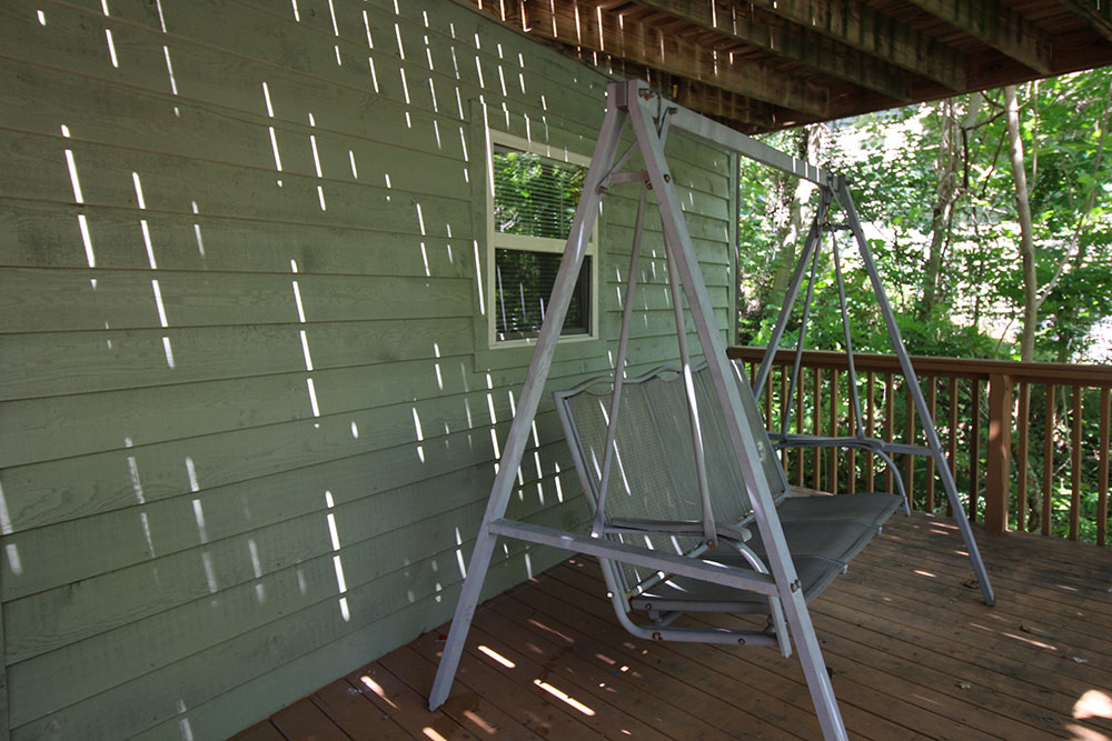 Norris Lake Cabin Rentals | Harmony Hill Lakeside Cabin View Porch Swing | Norris Lake Villas